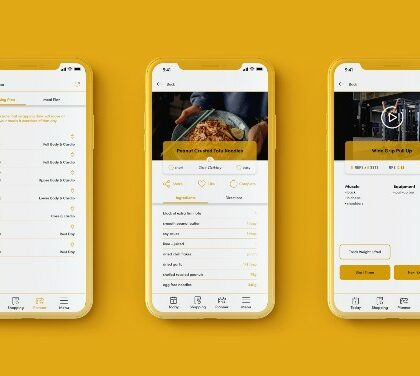 Photo shows an iPhone with different screens from the Oro app loaded on it. The iPhone is a gold/mustard yellow case reflecting the background to the picture which is the same colour, as is the primary colour scheme for the app as displayed on the screen