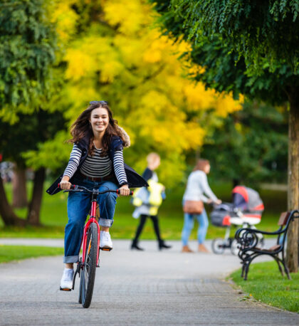 woman riding bike in city park