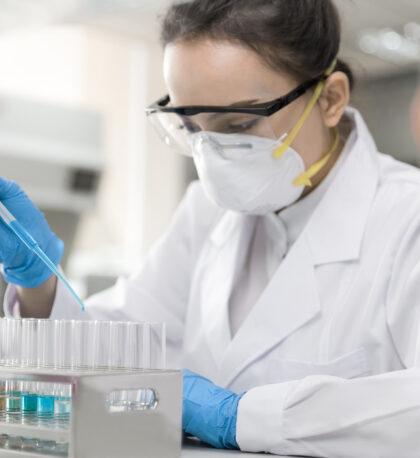 scientist testing sample